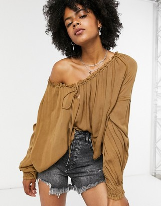 Free People Banda volume sleeve blouse in gold