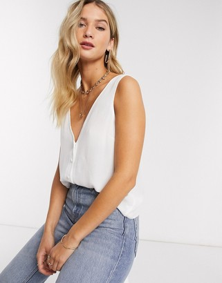 ASOS DESIGN v neck crinkle tank with button front in white