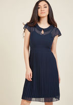 This prim chiffon dress is just as fitting for Monday's lecture as it is for Friday's festivities! Part of our ModCloth namesake label, this navy blue lovely uses a Peter Pan collar with a cute keyhole and a pleated skirt to portray your charming personal