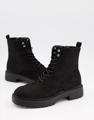 Schuh Anabelle lace up flat boots with brogue detail in black suedette