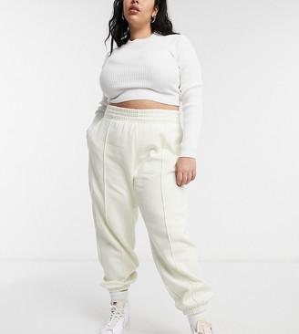 Nike Plus oversized fleece jogger in off white