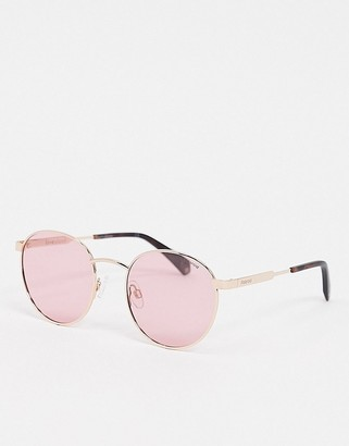 Polaroid X Love Island round sunglasses in gold with pink lens