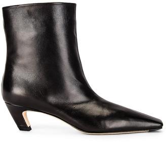 KHAITE Arizona Slouch Ankle Boots in Black | FWRD