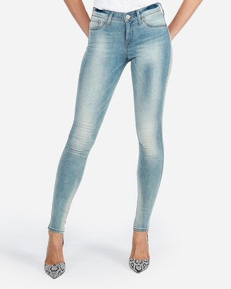Express Mid Rise Faded Skinny Jeans