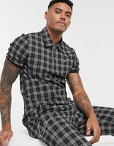 Mauvais polo with half zip in grey and black check