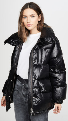 Exact Product: Kendall Jenner Black Oversized Puffer Long Jacket Street Style Autumn Winter 2020, Brand: Woolrich, Available on: shopstyle.com, Price: $529