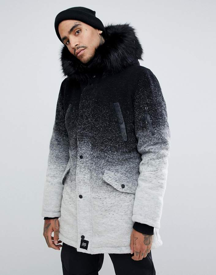 2553fa36d parka coat in faded black and white with faux fur hood