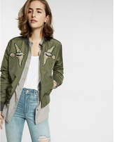 Express bird patch embellished filled bomber jacket