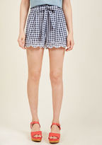 Ba7146 While flaunting these gingham shorts, it's easy to believe you're the most stylish you've ever been! A little flirty, a bit retro, and wholly adorable, this navy-and-white pair confirms your sartorial affirmations with its waistline tie, sweet embroidery,