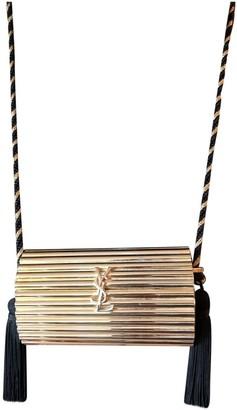 Saint Laurent Opium Gold Metal Clutch bags