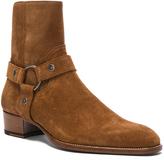 Saint Laurent Wyatt Suede Harness Boots in Brown.