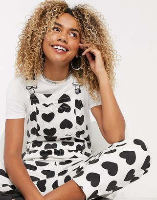 Lazy Oaf relaxed dungarees in all over heart print