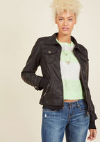 DB17083013 Casual, edgy, or somewhere in between - this black moto jacket nails each aesthetic perspective with effortless finesse! In addition to four pockets of the zipped and buttoned variety, this faux-leather layer offers up a removable knit hood for the ultima