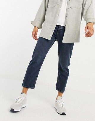 ASOS DESIGN relaxed tapered jeans in blue black wash