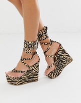Asos Design DESIGN Tribute thong tie leg wedges in tiger