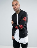 Criminal Damage Jersey Bomber Jacket In Black With Rose Sleeve Print