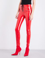 Unravel Lace-up skinny latex trousers