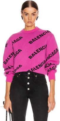 Balenciaga Long Sleeve Logo Crew Neck Sweater in Pink & Black   FWRD