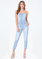 Bebe Torn Denim Lace Up Catsuit