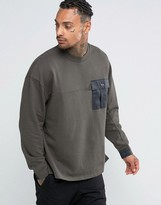 Asos Oversized Sweatshirt With Woven Chest Pocket