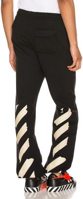 Off-White Tape Arrows Slim Sweatpant in Black Beige | FWRD