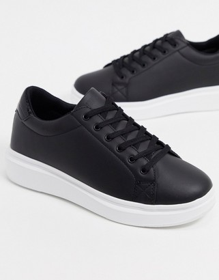 ASOS DESIGN trainers with chunky sole and contrast heel in black
