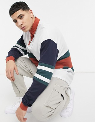ASOS DESIGN oversized long sleeve rugby polo with color block
