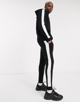 Asos DESIGN tracksuit with hoodie & side stripe in black