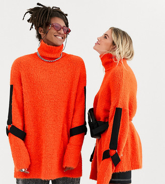 COLLUSION Unisex fluffy roll neck sweater with harness sleeve detail in orange