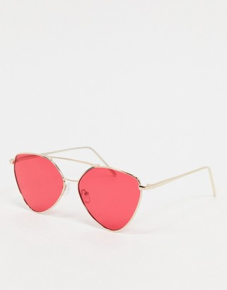 A. J. Morgan AJ Morgan angled sunglasses in gold with red lens