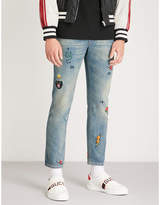 Gucci Patch-embroidered slim-fit tapered jeans