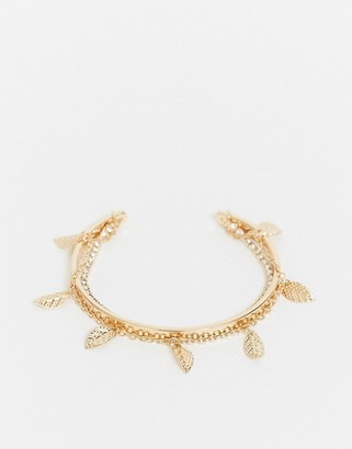 ASOS DESIGN cuff bracelet with dangle leaf charms in gold tone