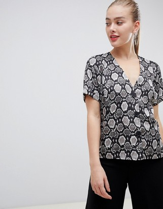 ASOS DESIGN boxy top with contrast buttons in snake animal print