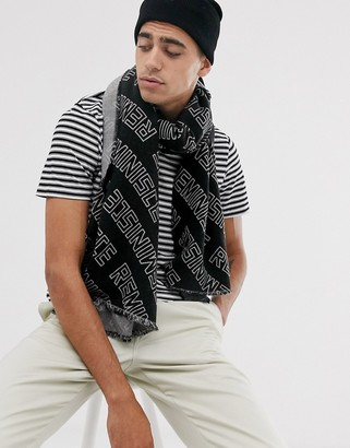 ASOS DESIGN woven scarf in black with repeat reminisce print