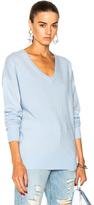 Frame Oversized V Neck Sweater in Blue.