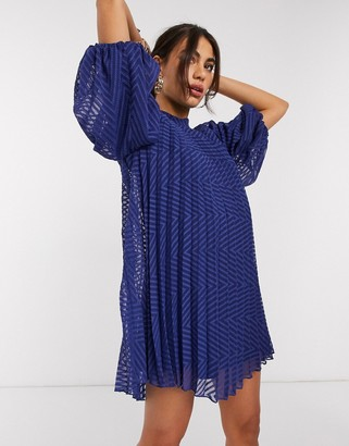 ASOS DESIGN pleated trapeze mini dress with puff sleeves in dobby in navy