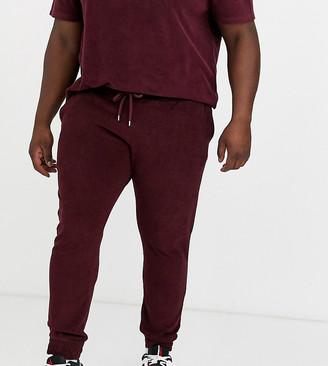 Asos Design DESIGN Plus two-piece skinny sweatpants in towelling in burgundy-Red