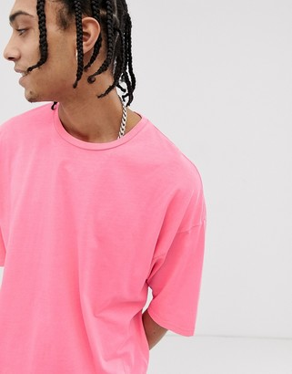 Asos DESIGN oversized t-shirt with half sleeve in washed neon pink