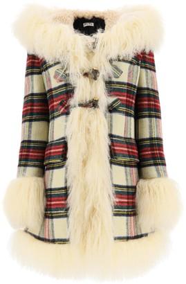 Miu Miu tartan coat with mongolian fur