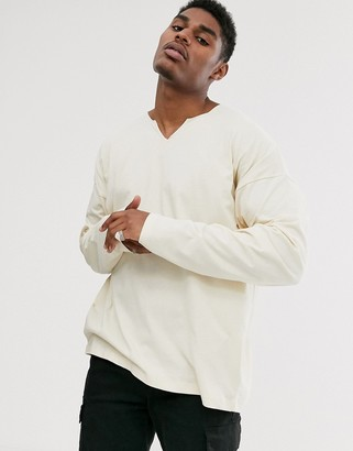 ASOS DESIGN oversized long sleeve t-shirt with raw notch neck in beige