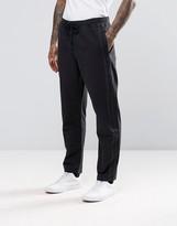 Asos Slim Jogger with Textured Stripe In Black