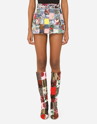 Dolce & Gabbana Denim Miniskirt With Interwoven Patchwork Detailing And Bejeweled Buttons
