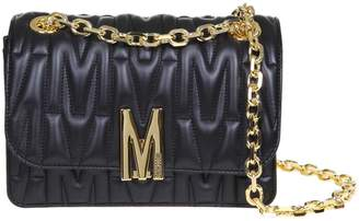 Moschino M Quilted Crossbody Bag In Black Quilted Leather