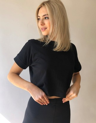 Asos Design DESIGN crop t-shirt with roll sleeve in black