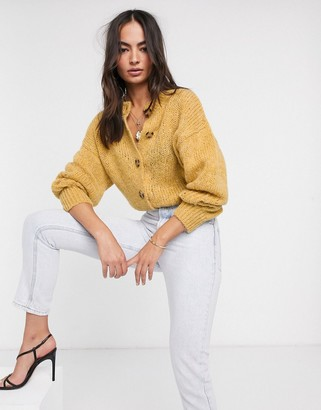 ASOS DESIGN crew neck cardi with button detail in fluffy knit