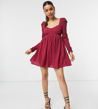 ASOS DESIGN Petite bustier mini babydoll dress in texture in oxblood