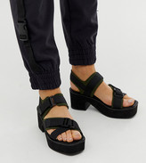 Asos Design DESIGN Wide Fit Ward chunky strappy mid heeled sandals in khaki and black