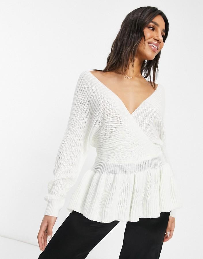 Parisian wrap front peplum sweater in cream