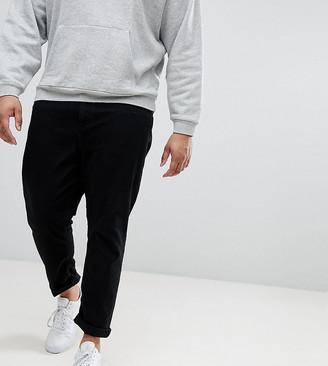 ASOS DESIGN Plus tapered jeans in black