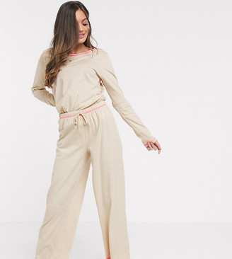 ASOS DESIGN petite mix & match jersey pants with neon overlock